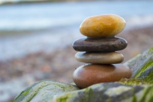 VibrationsCoaching:Reiki stones erected on a rocky beach