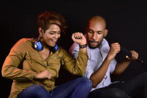 Vibrations Coaching: 5 ways to Raise Your Emotional Energy, two adults enjoying music together